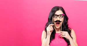 Young woman holding paper party sticks Royalty Free Stock Photography