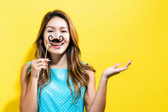 Young woman holding paper party sticks Royalty Free Stock Photos