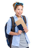 Young woman holding passport and information for the trip Royalty Free Stock Photo