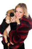 Young woman holding a pekinese Royalty Free Stock Photo