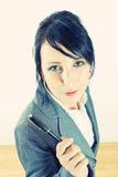 Young woman holding a pen stock photos
