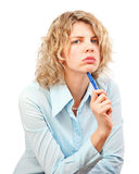Young woman holding a pen in hand Stock Images