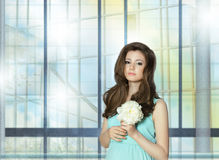 Young Woman Holding Peony Flower over the Window Stock Photos