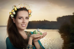 Young Woman Holding Perfume Bottle in Sunlight Stock Photography
