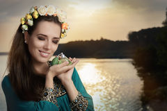 Young Woman Holding Perfume Bottle in Sunlight Royalty Free Stock Photo