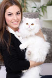 Young woman holding a Persian cat Royalty Free Stock Photos