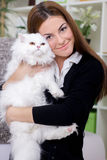 Young woman holding a Persian cat Royalty Free Stock Image