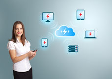 Young woman holding a phone with cloud computing network. Beautiful young woman holding a phone with cloud computing network Royalty Free Stock Photos