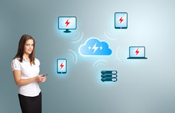 Young woman holding a phone with cloud computing network. Beautiful young woman holding a phone with cloud computing network Stock Photos