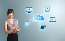 Young woman holding a phone with cloud computing network. Beautiful young woman holding a phone with cloud computing network Stock Photo