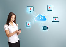 Young woman holding a phone with cloud computing network Stock Photo