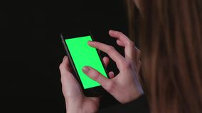 Woman is Holding Phone with green Screen Zoom Out stock video footage