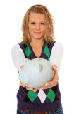 Young woman holding piggy bank Royalty Free Stock Photos