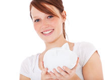 Young woman holding piggy bank Royalty Free Stock Photography