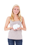 Young woman holding piggy bank Stock Photo