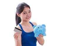 Young Woman holding piggy bank and card Royalty Free Stock Photos