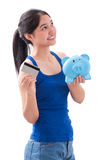 Young Woman holding piggy bank and card Stock Image