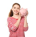 Young woman holding piggy bank on white background. Money savings concept royalty free stock photography