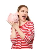 Young woman holding piggy bank on white background. Money savings concept stock photos