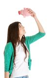 Young woman holding piggybank Stock Image