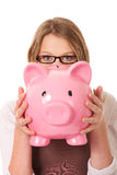 Young woman holding piggybank Royalty Free Stock Photo
