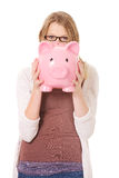 Young woman holding piggybank Stock Photo