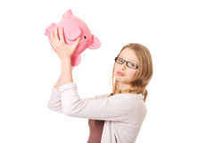 Young woman holding piggybank Stock Images