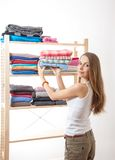 Young woman holding a pile of clothes Stock Photo