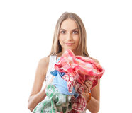Young woman holding a pile of clothes Stock Photography