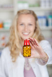 Young Woman Holding Pill Bottle Stock Photo