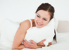 Young woman holding a pillow Stock Images