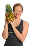 Young Woman Holding Pineapple Royalty Free Stock Photography