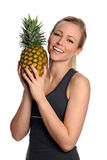 Young Woman Holding Pineapple Stock Photography