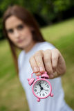 Young Woman Holding a Pink Alarm Clock Royalty Free Stock Photos