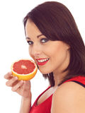 Young Woman Holding a Pink Grapefruit Stock Photos