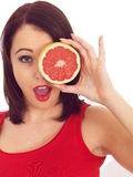 Young Woman Holding a Pink Grapefruit Stock Photo