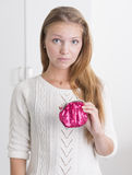 Young woman holding pink purse looking troubled Royalty Free Stock Photos