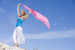 Young woman holding pink wrap Royalty Free Stock Photos
