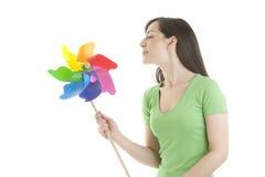 Young woman holding a pinwheel Stock Photos