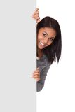 Young woman holding placard Royalty Free Stock Images