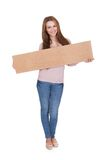 Young Woman Holding Placard Royalty Free Stock Photos