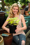 Young Woman Holding Plant Stock Photos