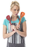 Young Woman Holding Plastic Serving Spoons Stock Photos