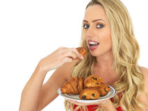 Young Woman Holding a Plate of mixed Danish Pastries Royalty Free Stock Image
