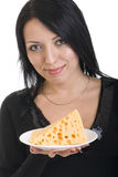 Young woman holding a plate with a slice of cheese Stock Image