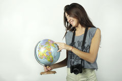 Young woman holding and pointing to globe. Stock Photography