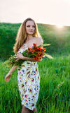 Young Woman holding  poppy bouquet Stock Photos
