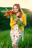 Young Woman holding  poppy bouquet Stock Image