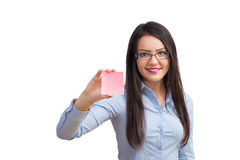 Young woman holding a post it Royalty Free Stock Photography