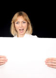 Young woman holding poster Royalty Free Stock Images